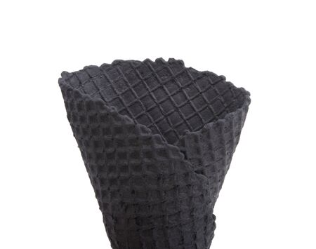 black waffle cone for ice cream isolated on the white