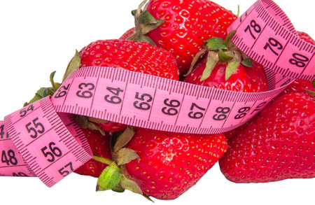 Red fresh strawberry with tape measure isolated on the white Stockfoto