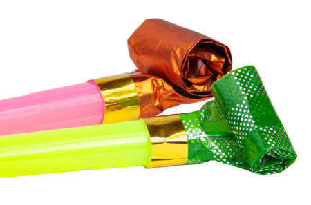 Party colorful foil noisemaker rolled or whistle isolated on the white