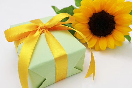 Gift and sun flower  photo