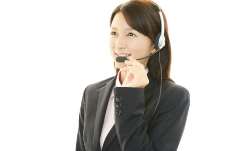 Smiling call center operator photo