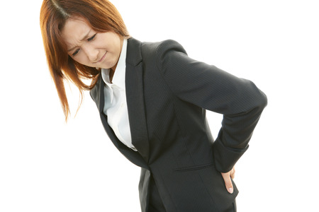 emotional pain: Business woman with low back pain
