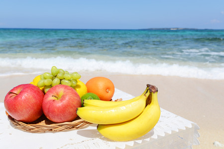 The refreshing seaside and fresh fruits photo