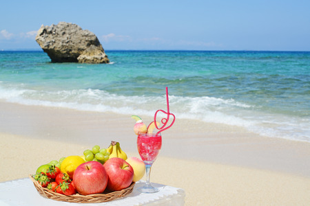 Fresh fruits and beautiful beach photo