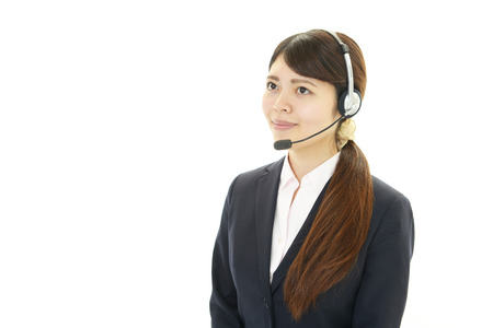 Smiling call center operator photo