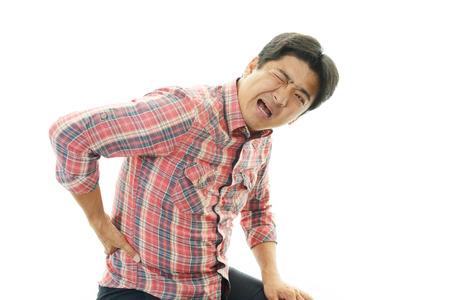 Man having a low back pain photo