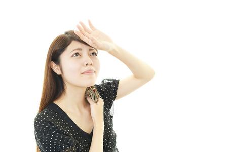 Vrouw zweet in de hitte Stockfoto