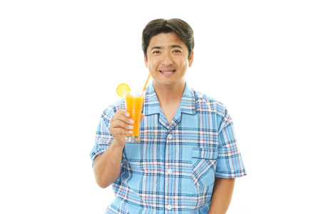 Man drinking blass of juice photo