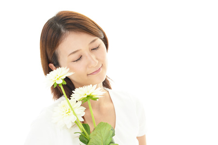 A woman with beautiful flower photo
