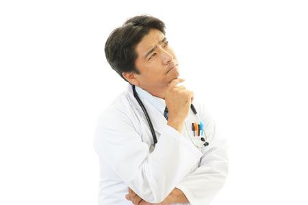 Doctor thinking  photo