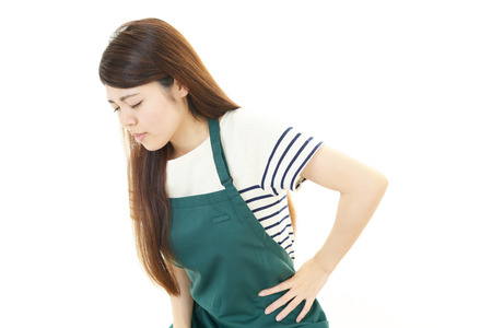 Woman with low back pain photo