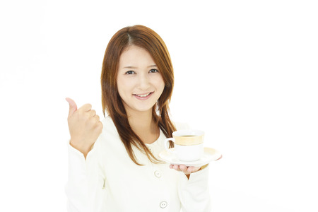 cofffee: Woman drinking a cup of coffee Stock Photo