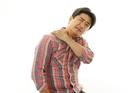 Man having a shoulder pain photo