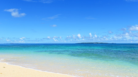 Tropical islands on the horizon over clear blue water of the coral lagoon photo