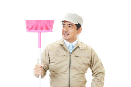 The male worker who poses happily on white background photo