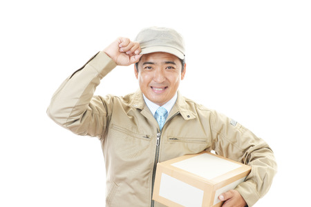 Smiling delivery man isolated on white background photo