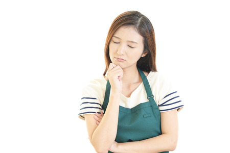 worries: Tired and stressed young asian woman