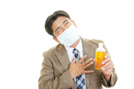 Businessman got a cold. All on white back ground . photo