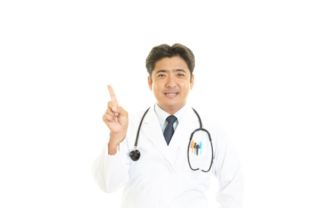 Asian medical doctor pointing photo