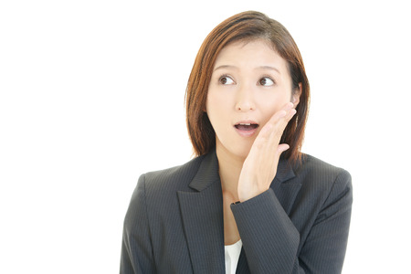 Surprised female office worker photo