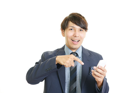 幸せな男持株スマート フォン