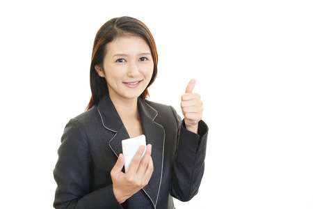 showed: Woman hold a Smart phone and showed thumb up Stock Photo