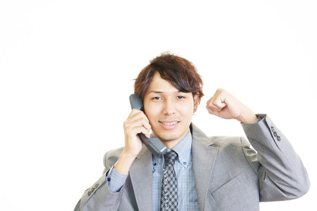 telephone salesman: Businessman with telephone Stock Photo