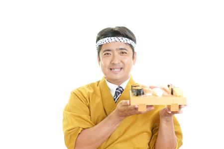 Portrait of a sushi chef photo