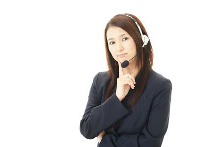 Stressed call center operator photo