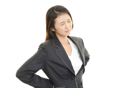 Business woman with back pain photo