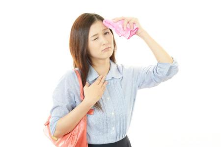 Vrouw veegde het zweet Stockfoto
