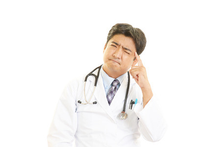 Doctor thinking Stock Photo