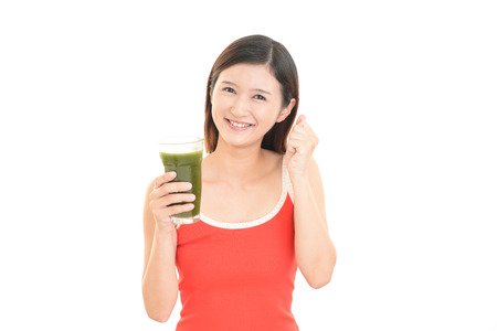 Woman drinking a glass of juice photo