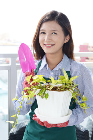 Woman to take care of plants photo