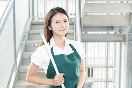 janitorial: A female Janitorial cleaning service Stock Photo