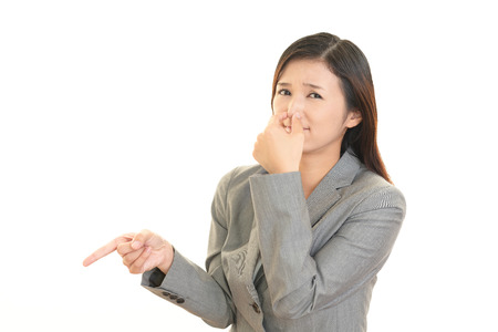 Women pinches her nose