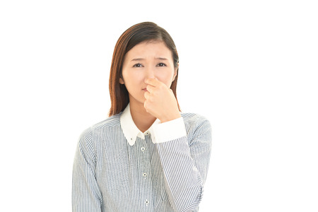 pinches: Women pinches her nose