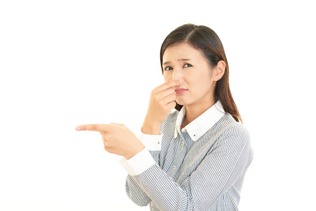 pinches: Woman pinches her nose