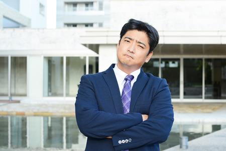 salaried worker: Depressed Asian businessman