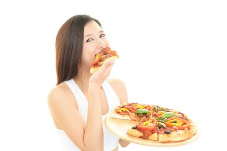 Die Frau, die apizza isst. Standard-Bild - 34414169