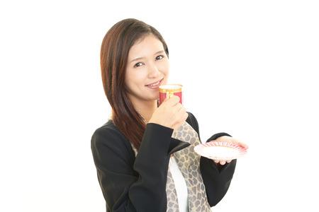 woman drinking tea: Business woman drinking tea. Stock Photo