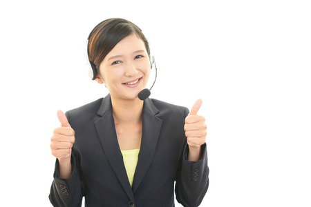 thumbs up sign: Call center operator showing thumbs up sign