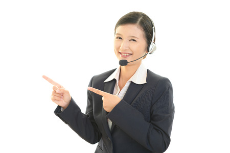 suggestions: Smiling customer services operator Stock Photo