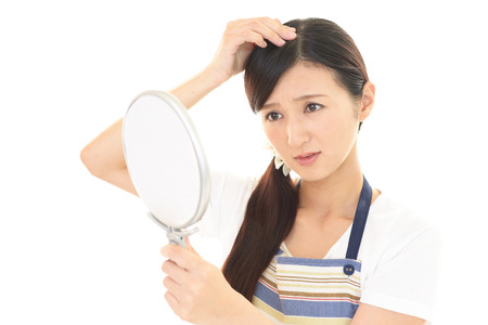 The unhappy woman in hair care Stock Photo