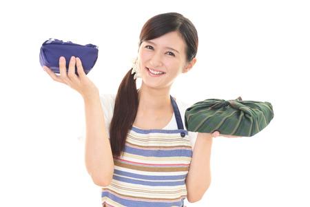 having lunch: woman having lunch box Stock Photo