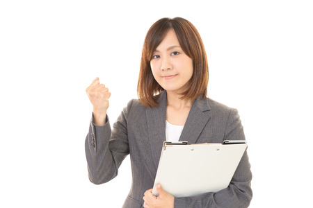 enjoys: The woman who enjoys working Stock Photo