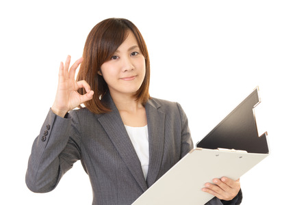 attractive office: The woman who enjoys working Stock Photo