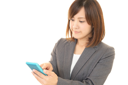 woman on phone: Woman with a smart phone