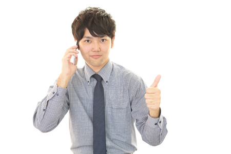 telephone salesman: Man who is talking on a smart phone
