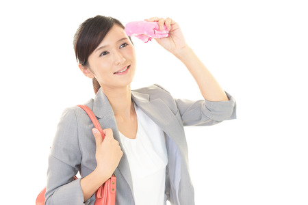 wiping: Woman wiping off the sweat